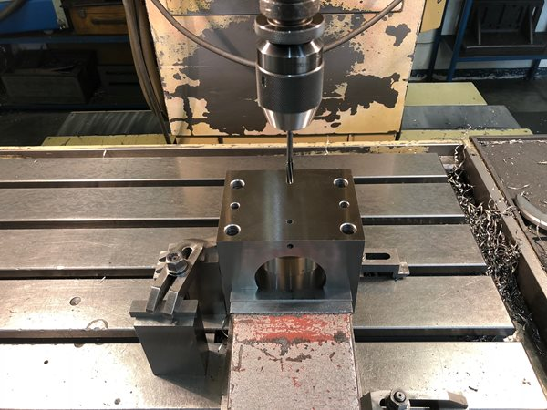 Precision drilling by jig boring machines